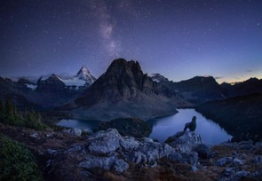 Assiniboine Dreams - Paul Zizka, Taken in the Mount Assiniboine Provincial Park in British Columbia, the photographer spent most of his night on the Niblet taking in the breath-taking view.