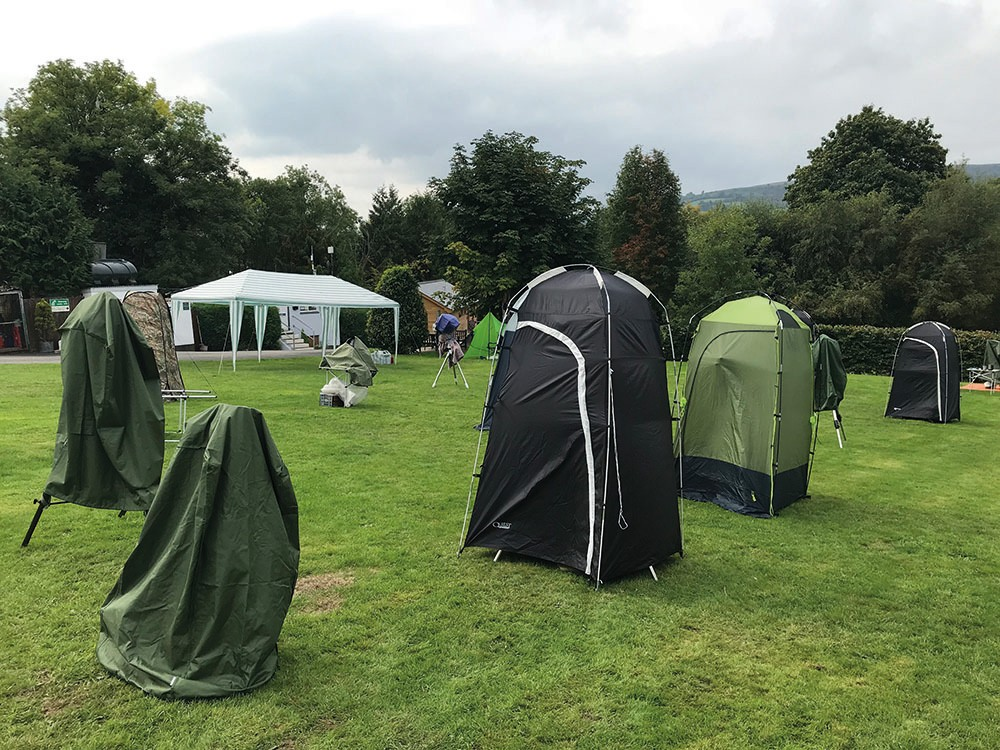 Not a scene from a 1970s Doctor Who episode, but covered telescopes at AstroCamp, awaiting the return of nightfall. Credit: Jamie Carter