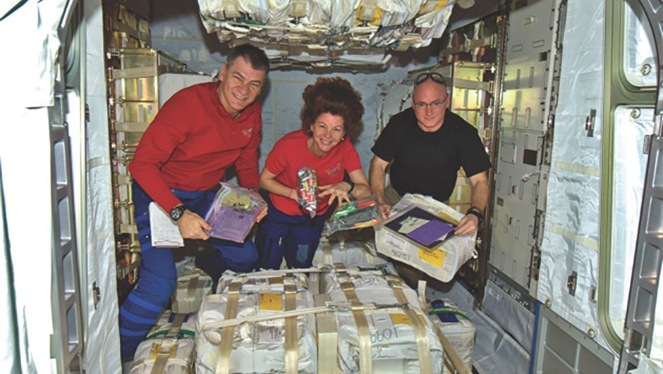 Expedition 26 open their care packages from Earth.Credit: NASA