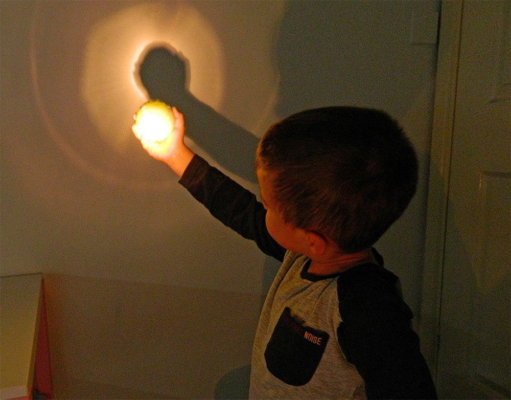 Teach kids about an eclipse with a tennis ball and torch. Credit: Steve Marsh
