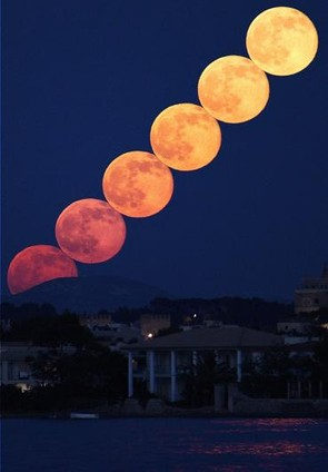 Full Moonrise Composite - Steve Knight, Taken from just outside Port de Pollenca in Majorca, the photographer set the camera to take images 2 seconds apart to create a timelapse. He then selected 6 images taken 140 seconds apart and stacked them using StarStax to get the effect of the moons just touching. The colour change in the rising moon illustrates a beautiful display of atmospheric Rayleigh scattering.