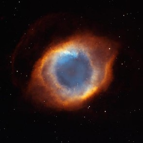 The Helix Nebula (NGC 7293) is a large planetary nebula, created by an expanding shell of gas given off by the central star. Credit: NASA/NOAO/ESA