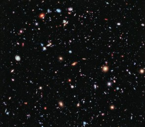 Showing how full our galaxy truly is, Hubble astronomers combined 10 years worth of images of the same patch of sky, an area only a fraction of the full Moon but found it was filled with hundreds of other galaxies. Credit: NASA/ESA