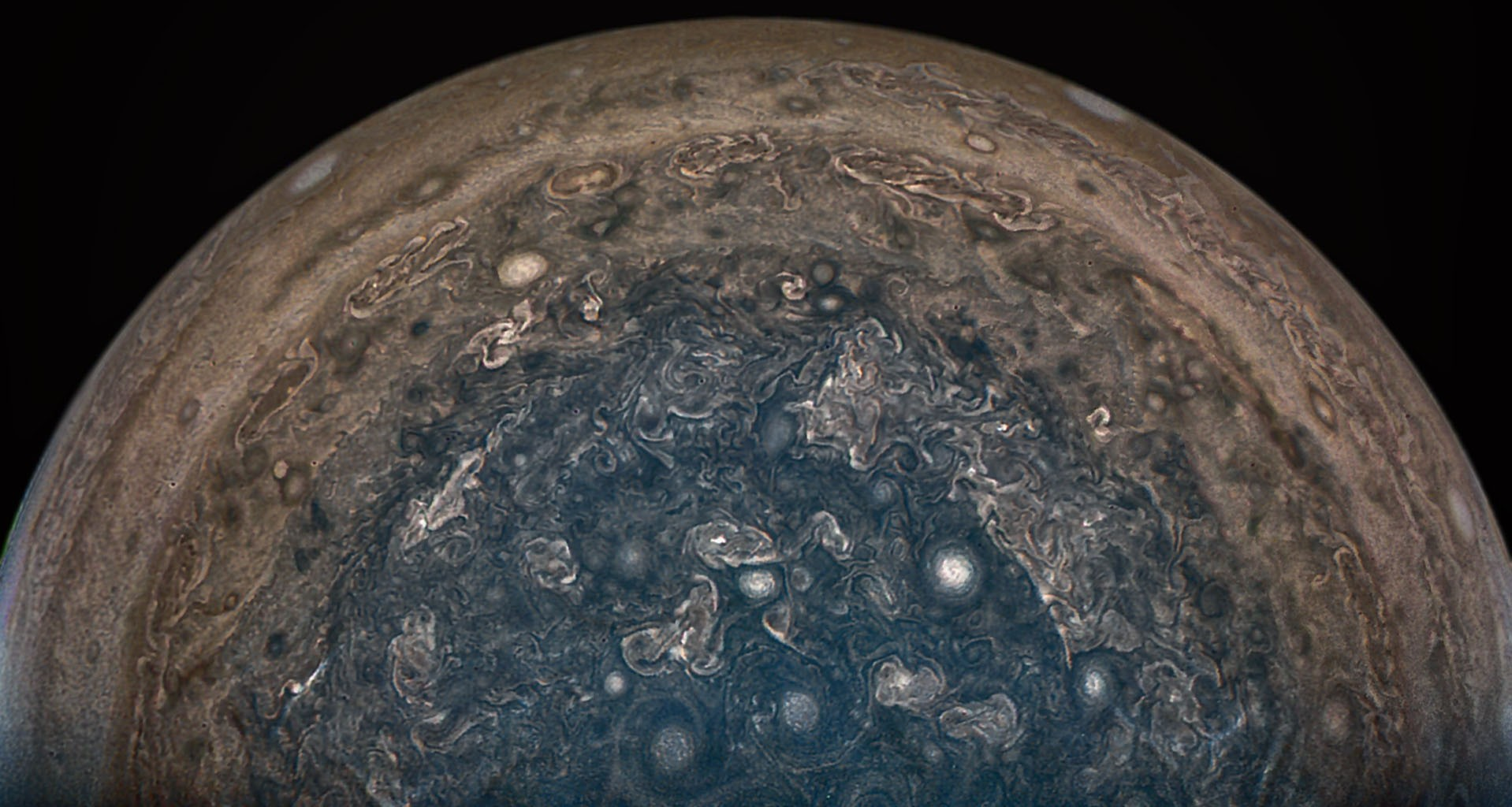 The Juno spacecraft has revealed images of Jupiter's poles, completely different from previous views of its stripy bands and Great Red Spot.Credit: NASA/JPL-Caltech/SwRI/MSSS/John Landino