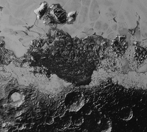 The diversity of Pluto's surface is visible in this shot, showing the various surfaces and landforms on the dwarf planet. This 350km wide image shows cratered terrain, mountains and a field of dark ridges that look like dunes.