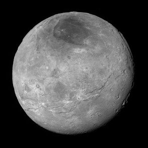 Charon's terrain is revealed in the highest quality image yet sent back by New Horizons, showing Pluto's moon's complex geological makeup. Fractured plains are seen in the lower right, while heavily cratered regions are seen in the centre and upper left portion.
