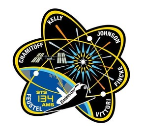 The shape of the patch for the crew of STS-134 was based on the international atomic symbol.