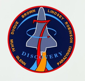 The design for mission STS-95 showed the shuttle rising over the sunlit limb of the Earth.