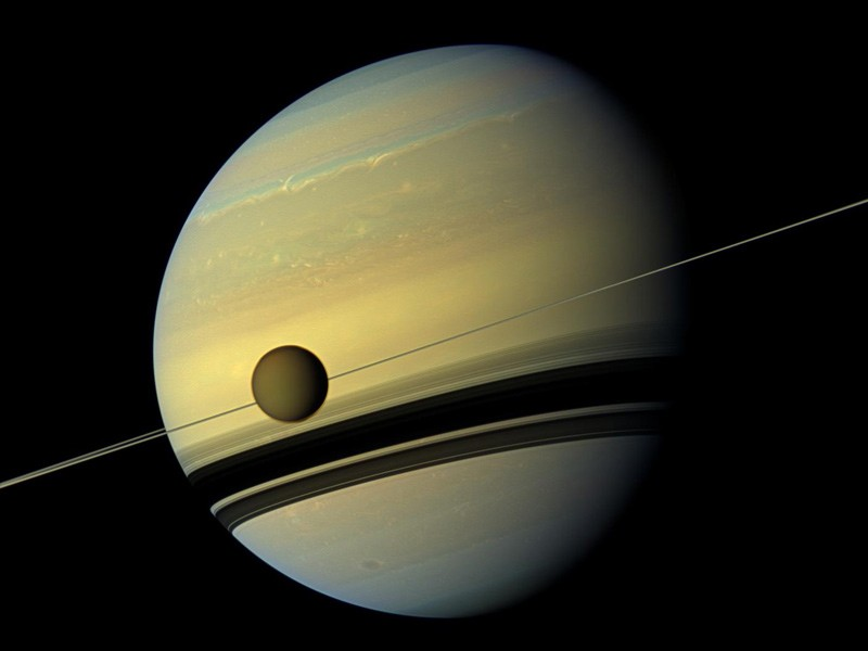 The moon Titan appears in front of Saturn in an image captured by NASA's Cassini spacecraft. Credit: NASA/JPL-Caltech/Space Science Institute
