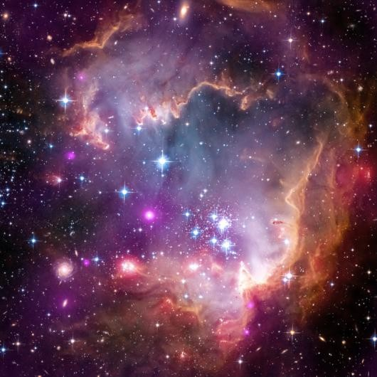 The Small Magellanic Cloud is one of the Milky Way's closest neighbours. While its visible to the naked eye, Hubble is able to show its beauty fully. Credit: NASA, ESA, CXC and the University of Potsdam, JPL-Caltech, and STScI