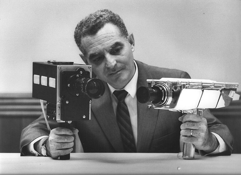 Stan Lebar is pictured holding two of Apollo's television cameras. On the left is the Field-Sequential Colour Camera and on the right the Monochrome Lunar Surface Camera, the very camera that caught Armstrong's first lunar steps on film. Credit: NASA