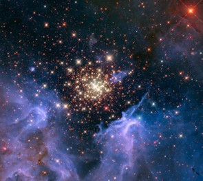This cluster of stars (NGC 3603) is surrounded by clouds of interstellar gas and dust, the raw materials for new star formation. Credit: NASA/ESA