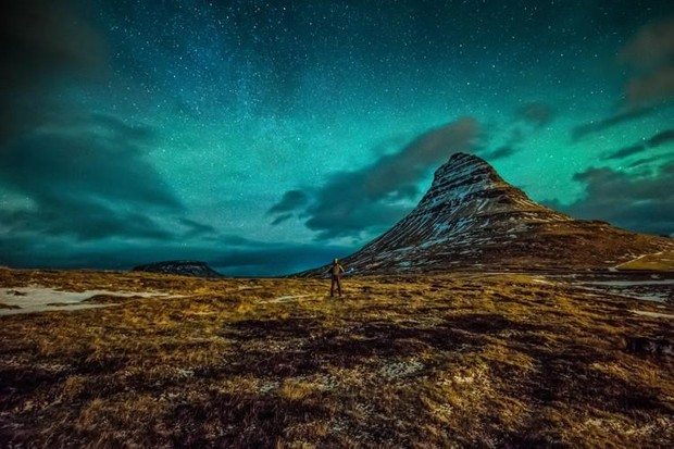 The Stars Among Us - Terence Kong, Taken in Kirkjufell, Iceland, the photographer was worried that on his first stargazing session in Iceland he would not have the best view of the night sky. With patience and a little luck after a couple of hours the storm clouds drifted away and revealed the sea of stars behind and took a self-portrait to document his experience.