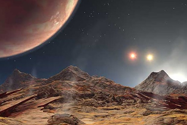 Artist's conception of the view from a hypothetical moon in orbit around a three-star system Credit: NASA/JPL-Caltech