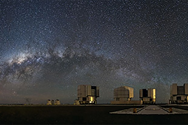 This stunning panorama shows the Milky Way galaxy arching above the platform of ESO's Very Large Telescope (VLT) on Cerro Paranal, Chile. At 2635 metres above sea level, Paranal Observatory is one of the very best astronomical observing sites in the world and is the flagship facility for European ground-based astronomy. The extent of our galaxy's cloudy and dusty structure can be seen in remarkable detail as a dim glowing band across the observation deck. From Earth, we see the Milky Way as a band across the sky because from our vantage point in one of its spiral arms we are seeing its disc-shaped structure edge-on as we peer towards its centre. Our galaxy is surrounded by several smaller satellite galaxies. Prominent here, to the left, are the Small Magellanic Cloud and Large Magellanic Cloud — dwarf galaxies which are members of our Local Group of galaxies. The VLT consists of four 8.2-metre Unit Telescopes (UTs) and four 1.8-metre Auxiliary Telescopes (ATs) which can be used together to form the ESO Very Large Telescope Interferometer (VLTI). Flickr user John Colosimo submitted this photograph to the Your ESO Pictures Flickr group. The Flickr group is regularly reviewed and the best photos are selected to be featured in our popular Picture of the Week series, or in our gallery. Link:  This photograph on John Colosimo's Flickr photostream