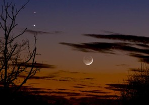 Venus and Mars in conjunction with Moon below Feb 20 2015 - Martin Campbell, Looking at the western evening sky on February 20th 2015, the photographer was aware that dazzling Venus and the red planet Mars had been locked in a celestial embrace over the previous few nights. When a young crescent Moon muscled in on the planetary dance it provided him with a compelling photographic opportunity.