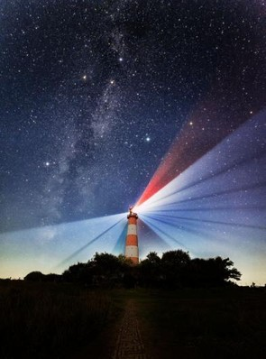 Westerhever at Night - Tom Davidson, Light rays emitted by the light house streaking across the night sky are captured by a long exposure (20s). One of the glasses in the lighthouse creates a red beam, contrasting with the southern part of the Milky Way visible on the left of the photograph.