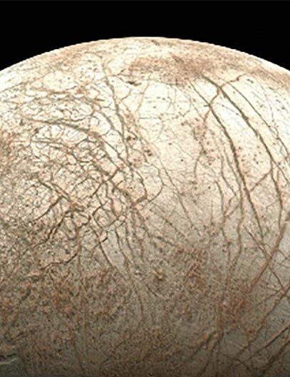 Europa viewed from NASA's Galileo spacecraft. Note the bright ice, huge cracks and dark patches that probably contain both ice and dirt Image: NASA/Ted Stryk
