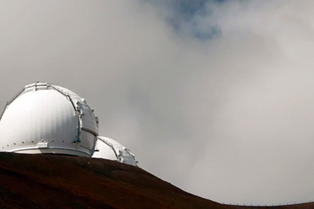 The twin telescopes at the WM Keck Observatory under unforgiving skies. Image Credit: Thinkstock