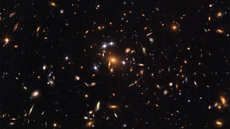 Credit: NASA, ESA, K. Sharon (Tel Aviv University) and E. Ofek (Caltech)This Hubble image shows gravitational lensing in action as the light from a distant quasar is bent and multiplied by the gravity of a cluster of galaxies in front of it.