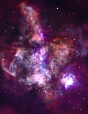 30 Doradus Also known as the Tarantula Nebula, this is one of the largest star-forming regions near the Milky Way. Chandra can observe gas that is being heated to millions of degrees by the streams of charged particles released by hot young stars, known as 'stellar winds'. Credit: NASA/CXC/Penn State Univ./L. Townsley et al.