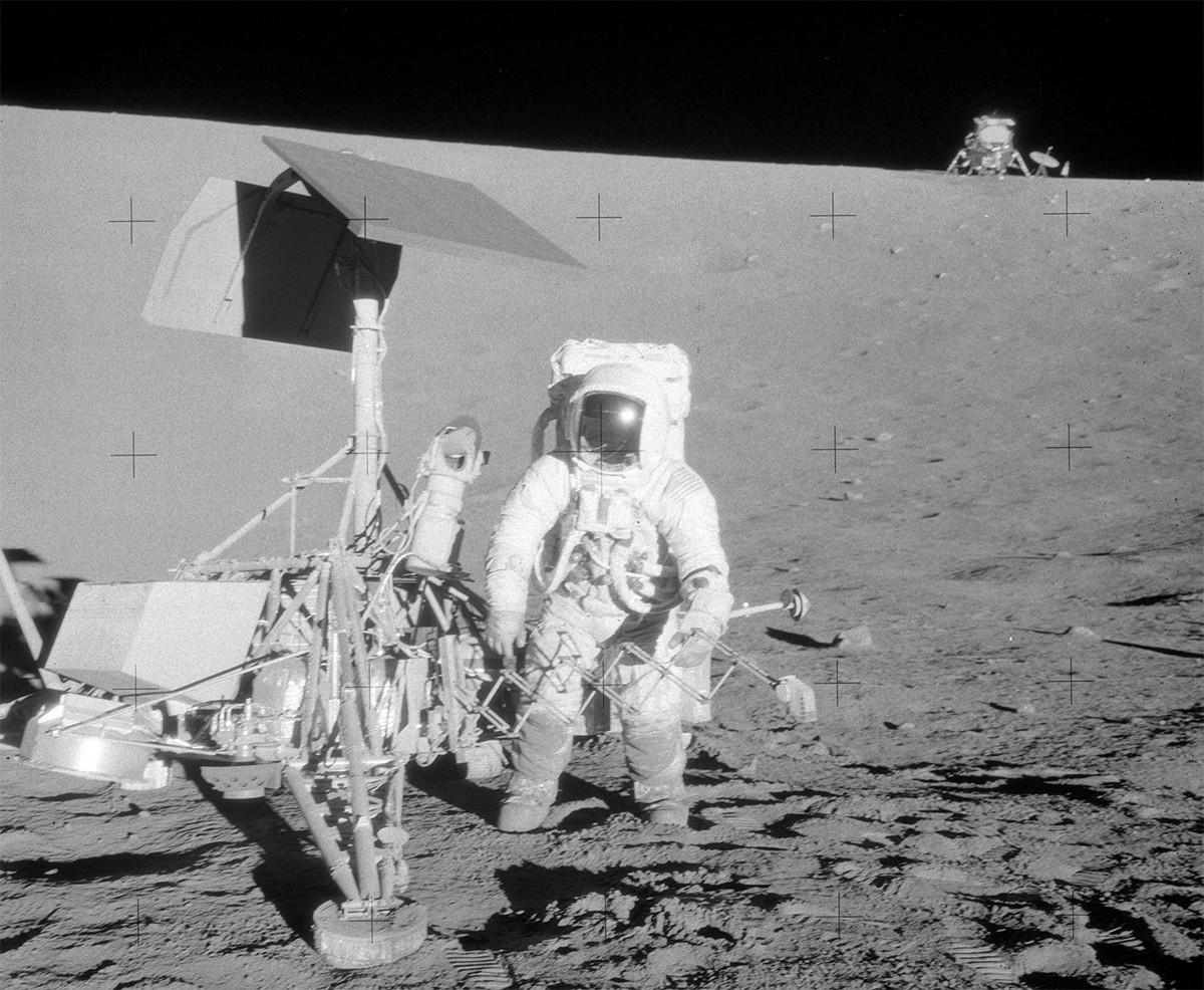 Alan Bean poses next to Surveyor III during Apollo 12. Credit: NASA