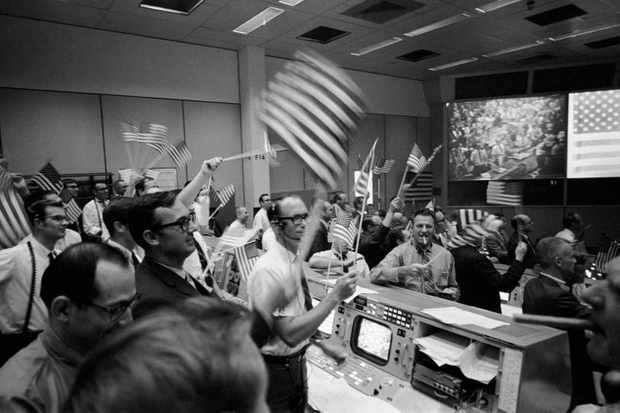 Flight light controllers celebrate the conclusion of Apollo 11 on Jul 24, 1969. Credit: NASA