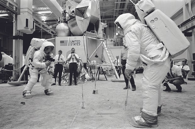 Neil Armstrong and Buzz Aldrin practise taking photos of a lunar sample area. Credit: NASA