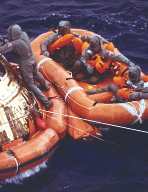 24 July 1969. Columbia made splashdown at 4.50pm GMT. Half an hour later, the crew, dressed in their isolation garments, wait to be picked up by helicopter while a Navy diver secures the open hatch. Credit: NASA