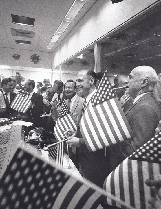 24 July 1969. On hearing the news of a safe splashdown celebratory cigars are lit at mission control in Houston. Credit: NASA