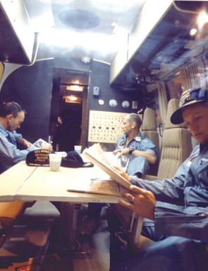 26 July 1969. The crew relax in the quarantine facility while the USS Hornet sails for Hawaii. Credit: NASA