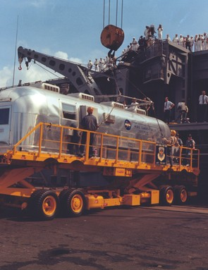 26 July 1969. When it arrives in Hawaii, the mobile quarantine facility still containing the crew is off-loaded from the USS Hornet ready for its flight back to Houston. Credit: NASA