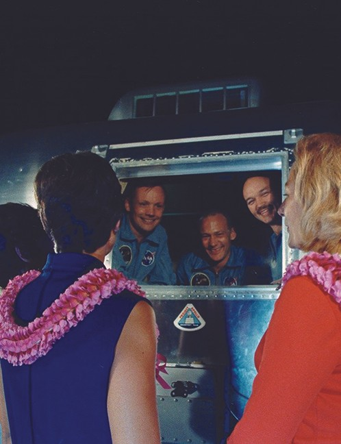 27 July 1969. Still in their quarantine trailer on arrival in Houston, the crew see their wives for the first time since returning to Earth. From left: Patricia Collins, Jan Armstrong and Joan Aldrin. Credit: NASA