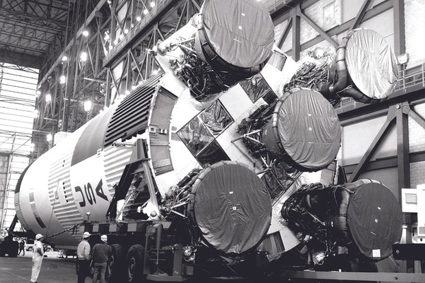 21 February 1969. Engineers oversee the transport of Saturn V's S-IC first booster stage in the transfer aisle of the Vehicle Assembly Building. Credit: NASA