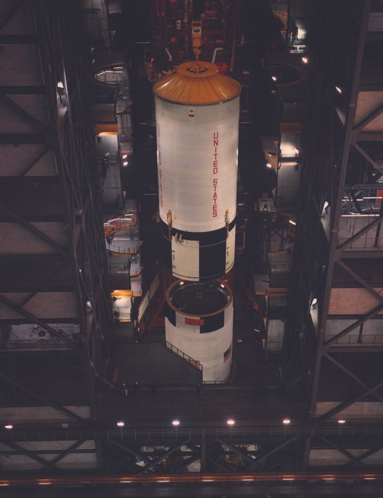 21 March 1969. Saturn V's S-II second stage is hoisted into position ready to be attached to the S-IC first stage. Credit: NASA