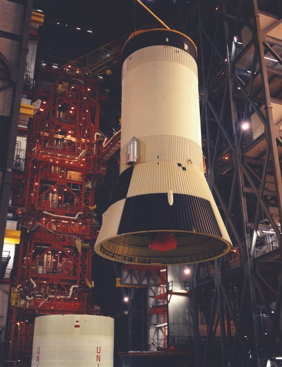 21 March 1969. The rocket's S-IVB third stage is moved over the second stage. Credit: NASA