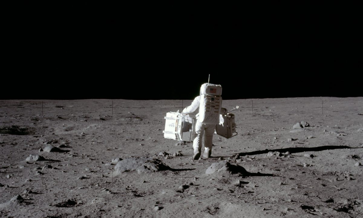 Buzz Aldrin carries the Passive Seismic Experiments Package and the Laser Ranging Retroreflector during Apollo 11. Credit: NASA