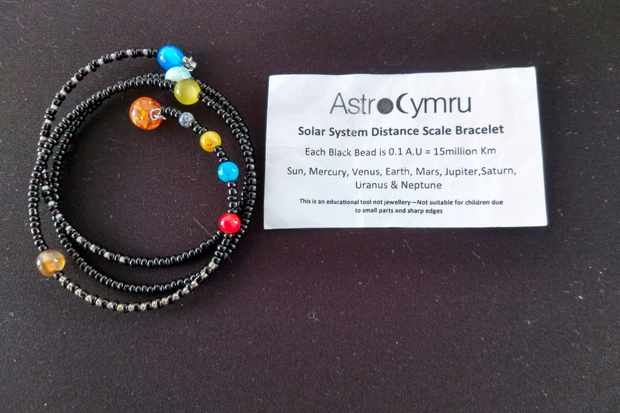 A Solar System Distance Bracelet that helps put across the scale of the Solar System to visually impaired astronomers. Credit: Astro Cymru