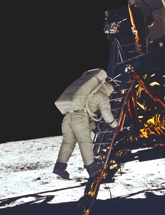 Buzz Aldrin descends the Lunar Module ladder to become the second person to walk on the Moon