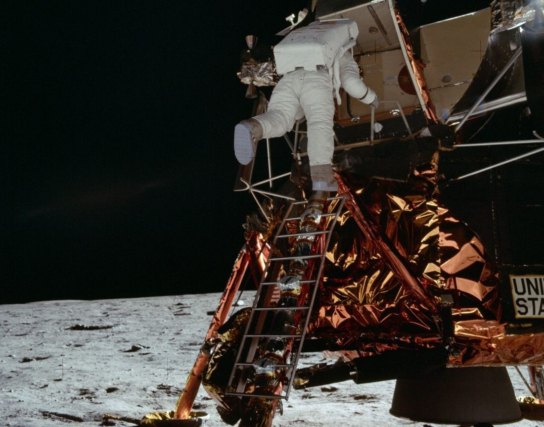 Buzz Aldrin descends the Lunar Module ladder to reach the surface of the Moon. Credit: NASA