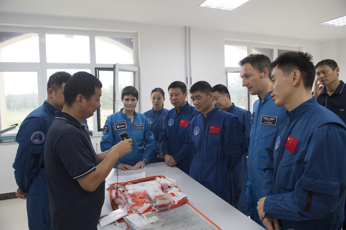 Collaboration between the US and China in space may be currently off-limits, but ESA has been working with the China National Space Administration. In August 2017, ESA astronauts Samantha Cristoforetti and Matthias Maurer joined Chinese colleagues in Yantai, China for some sea survival training. Credit: ESA–Stephane Corvaja, 2017