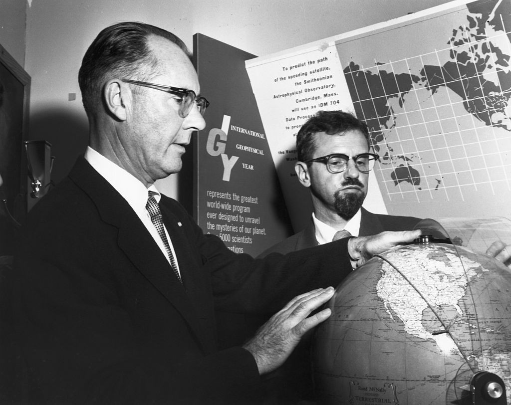 Dr. Fred L. Whipple (left), Director of the Smithsonian Observatory and Dr. J. Allen Hynek, chief of Operation Moonwatch, discuss the possible path of the Sputnik satellite at the Smithsonian Observatory, 4 October 1957. Credit: Bettmann / Contributor / Getty Images