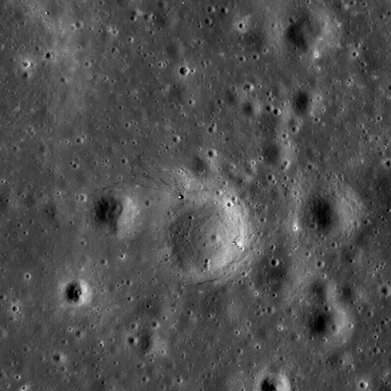 Boulders perched on the summit of the central peak of Tsiolkovskiy crater are seen in this image from NASA's Lunar Reconnaissance Orbiter.