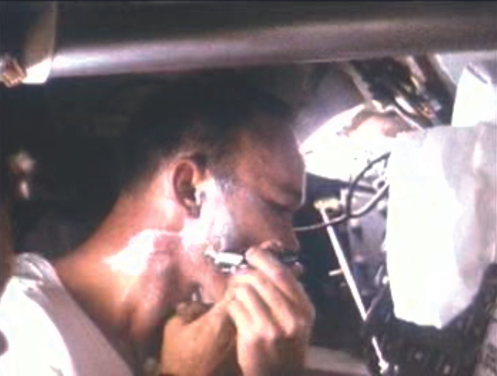 Michael Collins has a shave after nearly eight days in space. Credit: NASA