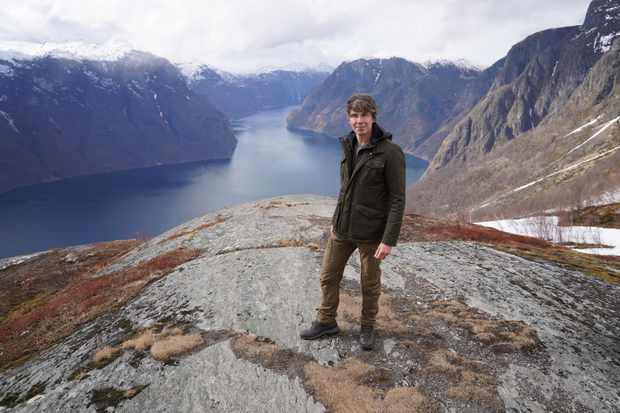 Professor Brian Cox on location at Stegastein, overlooking Aurlandsfjorden in Norway. Although today Venus is hot and hostile, this has not always been the case. Before our neighbouring planet was gripped by an extreme green house effect, there was water. Much like there is on Earth today. Credit: BBC