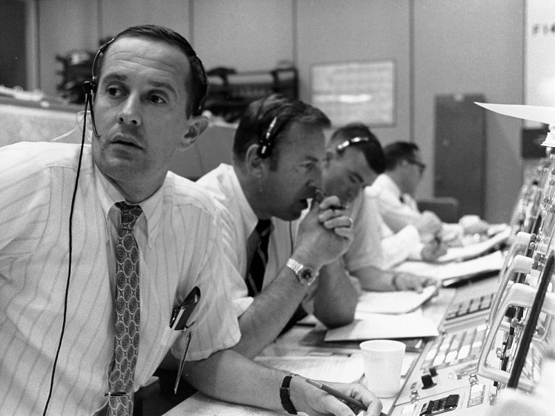Charlie Duke (left), Jim Lovell (middle) and Fred Haise (right) pictured in Mission Control. Credit: NASA