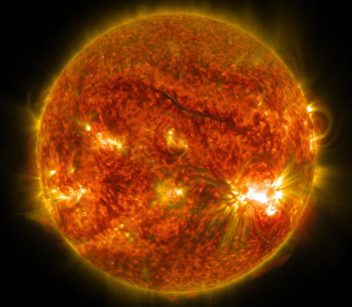 An image of the Sun showing solar flares erupting from its surface, the largest of which can be seen on the lower right. The image was captured by NASA's Solar Dynamics Observatory on 26 October 2014. Credit: NASA/SDO