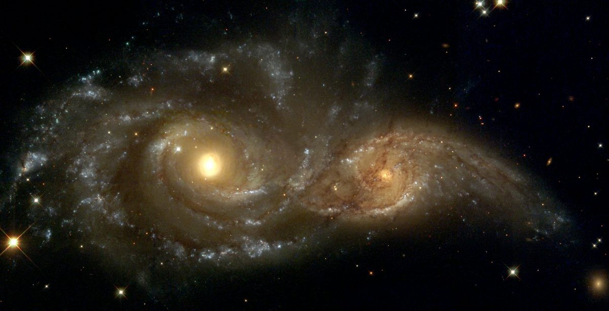 Merging galaxies NGC 2207 and IC 2163, as seen by the Hubble Space Telescope. Credit: NASA/ESA and The Hubble Heritage Team (STScI)