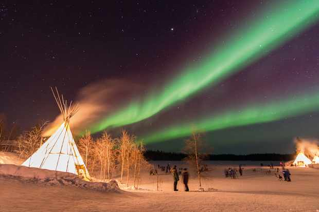 Aurora Over Teepees, Yellowknife. Credit: iStock/ Getty Images