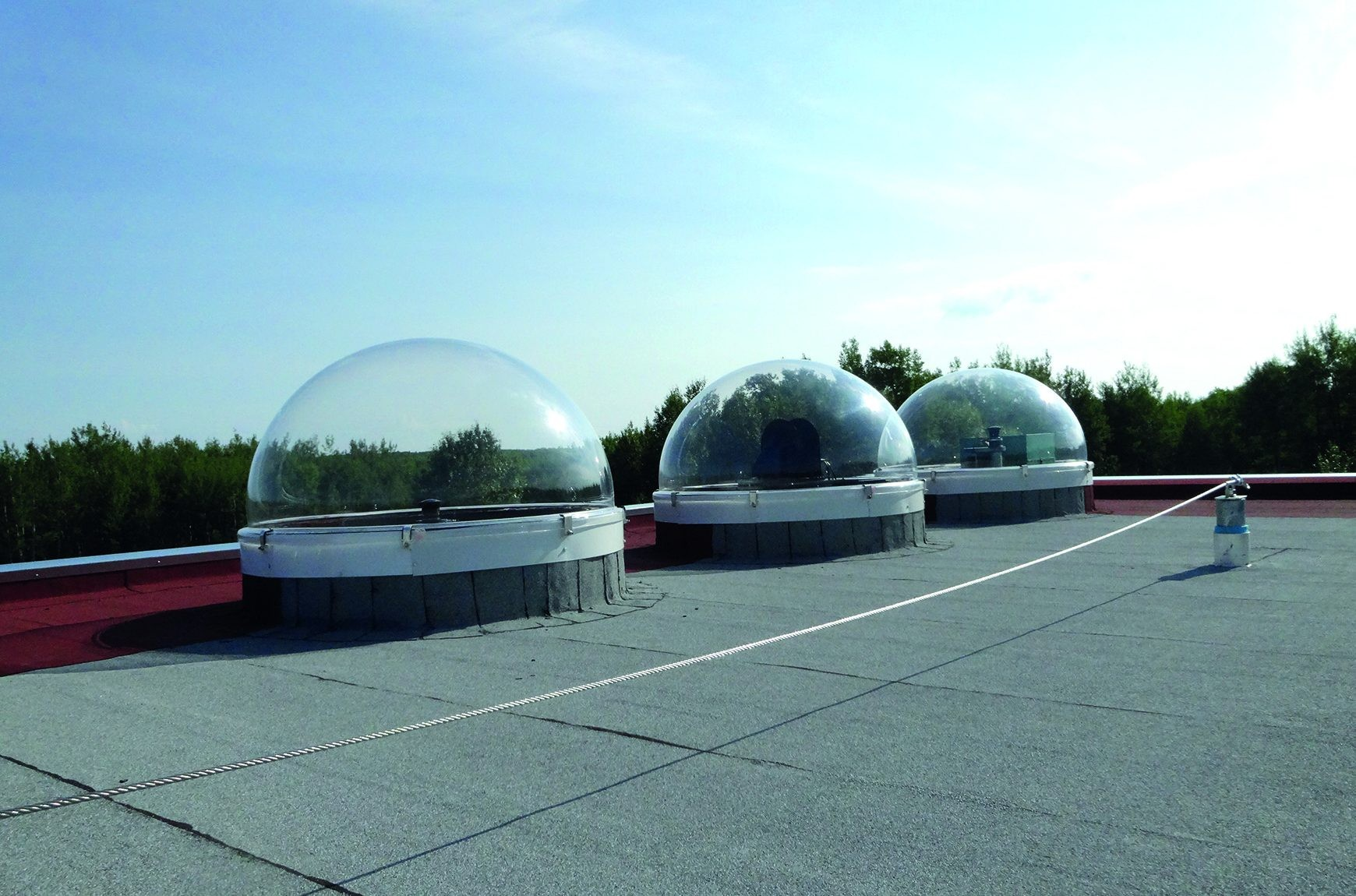 Modified CCDs with fisheye lenses sit within these domes in Athabasca. Credit: Melanie Windridge